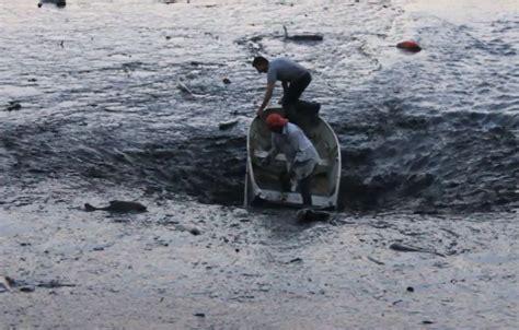 fishing boat killing enormous sinkhole drains lake in franca brazil killing