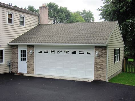custom home garage garages by opdyke custom built to match your home