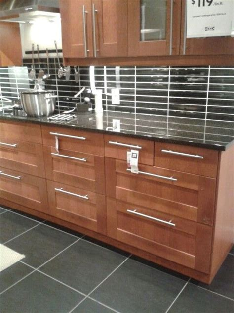 medium brown kitchen cabinets adel medium brown cabinets with a eye catching backsplash ikea kitchen design