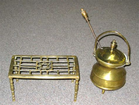 two antique brass fireplace accessories a footed 678489