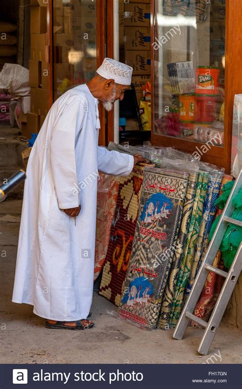Looking For Rugs by An Elderly Omani Looking For Carpets Rugs In The Nizwa