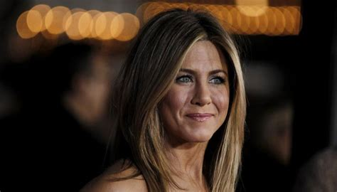 Aniston To Adopt by Aniston S Rep Denies Adoption Report And More