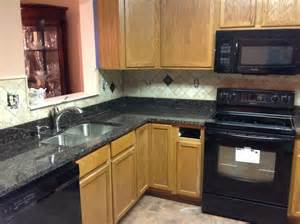 black granite countertops with tile backsplash home