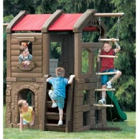 step2 naturally playful playhouse climber and swing adventure lodge play centre w glider best educational