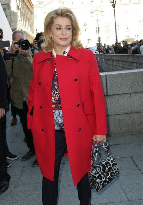 catherine deneuve louis vuitton the 20 best celebrity bag looks from paris fashion week