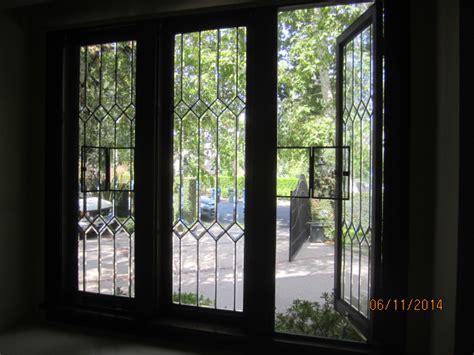 bronze interior window screens with wickets for crank - Interior Window Screens
