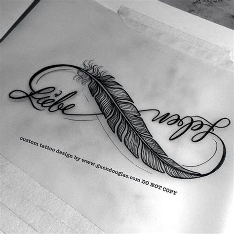 infinity tattoo with feather i really like the feather incorporated in this