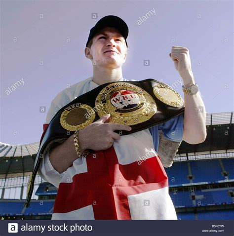 ricky hatton seen here hold his wbu title belt which he