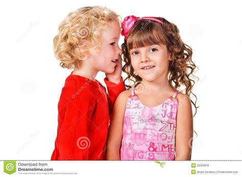 With A Secret boy tell a secret to a stock photo
