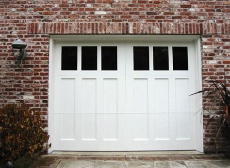 made custom wood garage doors and real carriage house