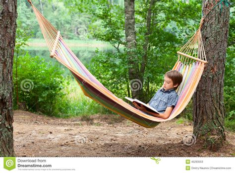 Book Hammock child reading book in hammock