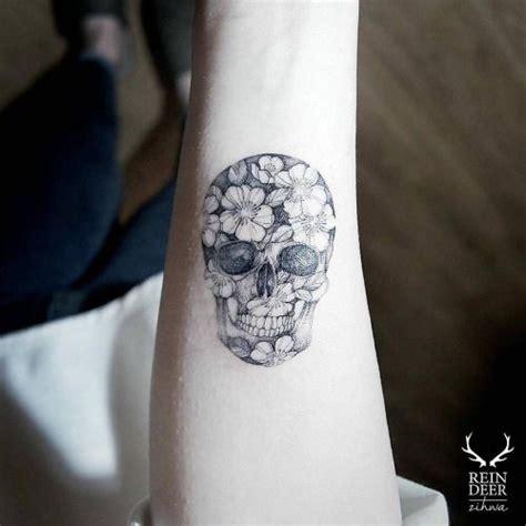 sick wrist tattoos flower skull on the right inner arm artist