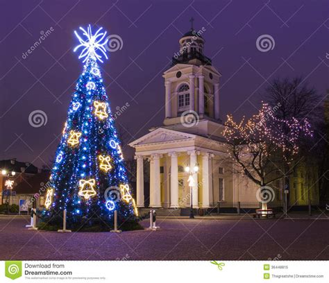 christmas tree near old church in ventspils stock image