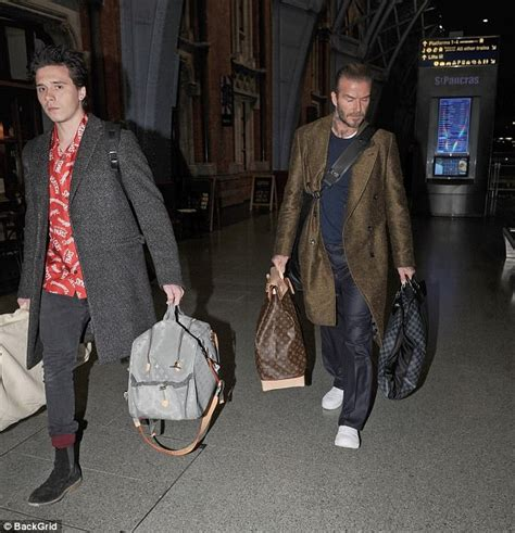 Louis Vuitton David Beckham With His Louis Vuitton Sac Squash And Pegase Luggage by David Beckham And Arrive Back In