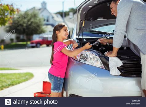 Kaos Dads Auto Shop and fixing car engine stock photo royalty
