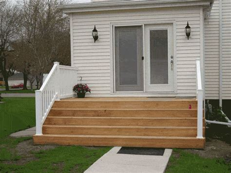 liking the wide step idea for kitchen patio doors and then a platform deck around stairs so