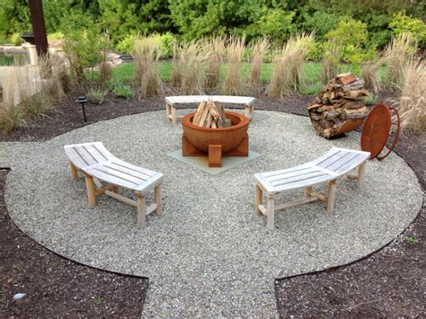 Pool waterfall ideas, crushed stone patio with fire pit
