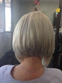 different ways to wear a stacked bob mid length bob with long layers and slight face frame