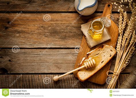 Honey In A Jar, Slice Of Bread, Wheat And Milk On Vintage