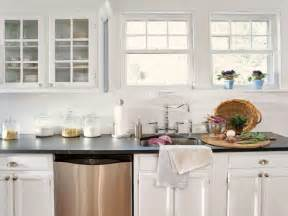 Kitchen with white glass wooden wall cabinets also wooden drawers and