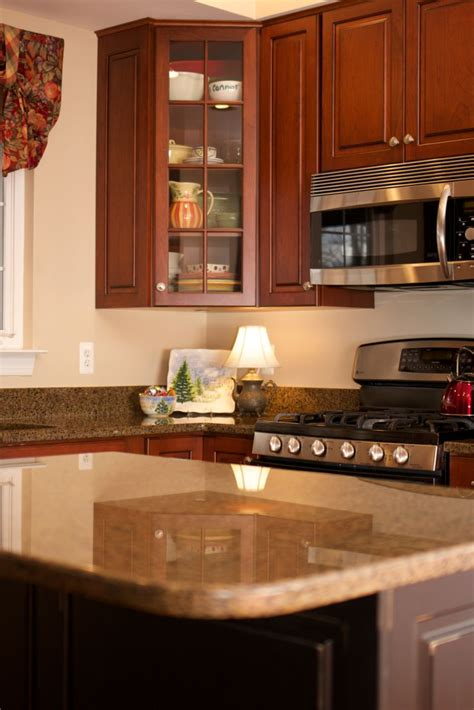 Ideas For Refacing Kitchen Cabinets by Antiqued Black Island With Cherry Kitchen Cabinets A