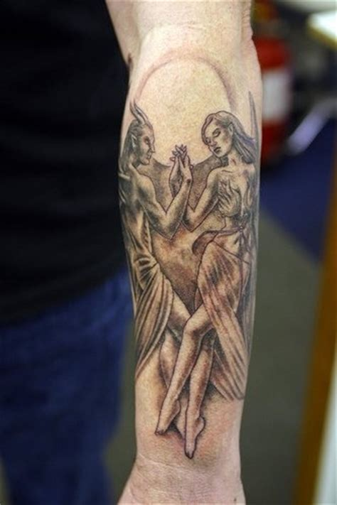 dancing with the devil forearm tattoo inked body