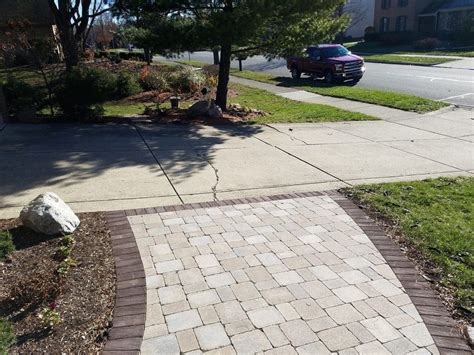 concrete patio pavers how to ensure your concrete or a paver driveway will