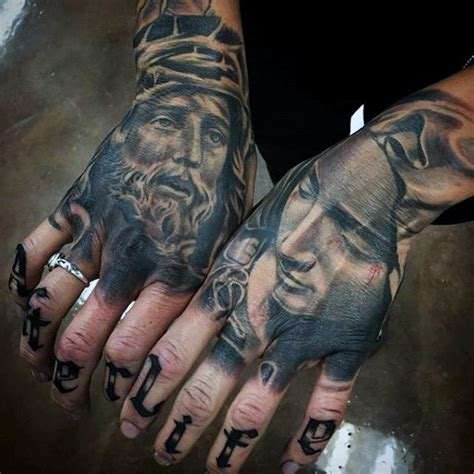 christian tattoo on hand 100 religious tattoos for men sacred design ideas