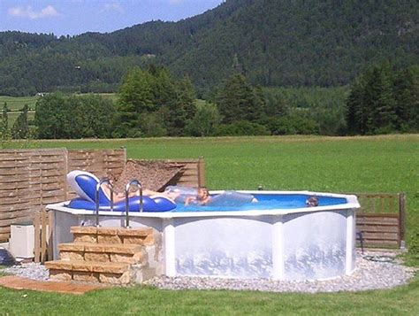 Decorating Ideas Around Above Ground Pool Above Ground Swimming Pools Landscaping Ideas With Deck