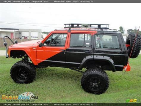 orange jeep cherokee 1992 jeep cherokee sport 4x4 orange black gray photo 2