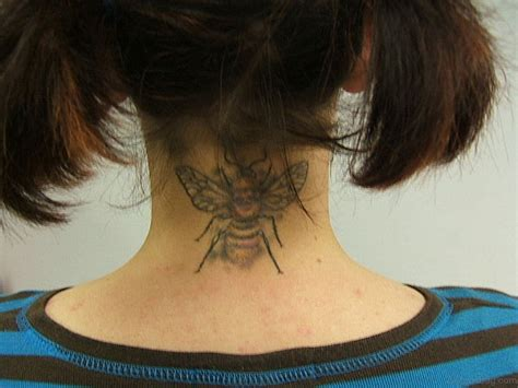 tattoo on nape of neck designs 22 neck tattoos