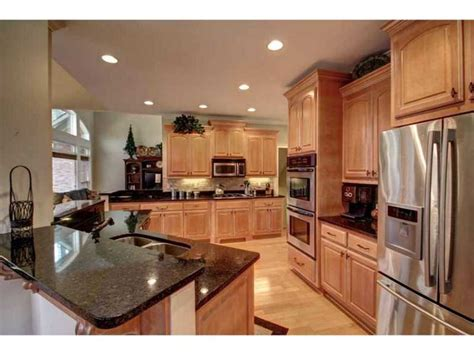 kitchen wall colors with light wood cabinets kitchen stainless steel dark granite counter tops light