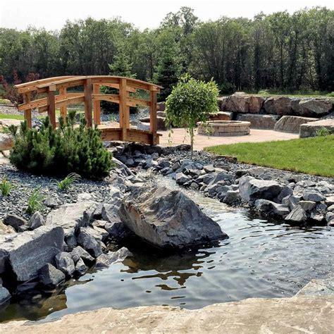 Landscape Architecture Winnipeg Incorporate Boulders Into The Landscape For Form Colour