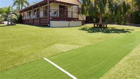backyard cricket pitch oxenford home comes with putting green and cricket pitch