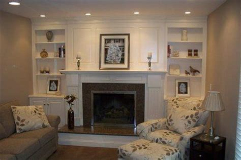 shelves next to fireplace with lighting house ideas