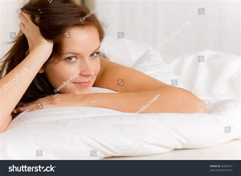 how to make a woman happy in bed bedroom happy woman in white bed waking up stock photo