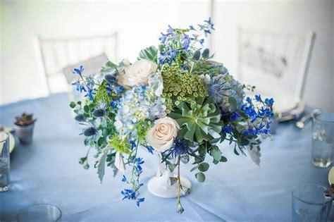 light blue flower arrangements sophisticated floral designs white compote floral