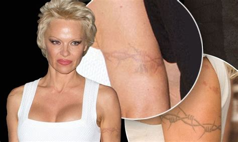 pamela anderson s barbed wire tattoo has nearly