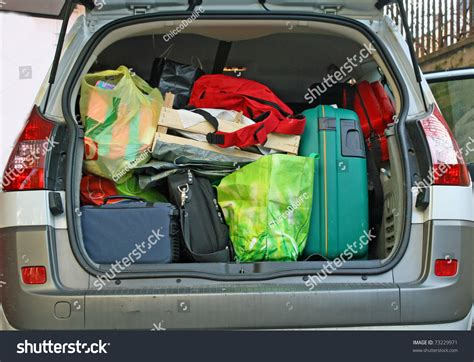 leaving in car overloaded trunk of a car leaving for the winter holidays with your family stock photo