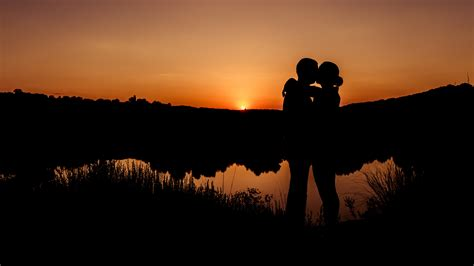 anime couple at sunset wallpaper romantic kiss couple sunset hd 5k love 5913