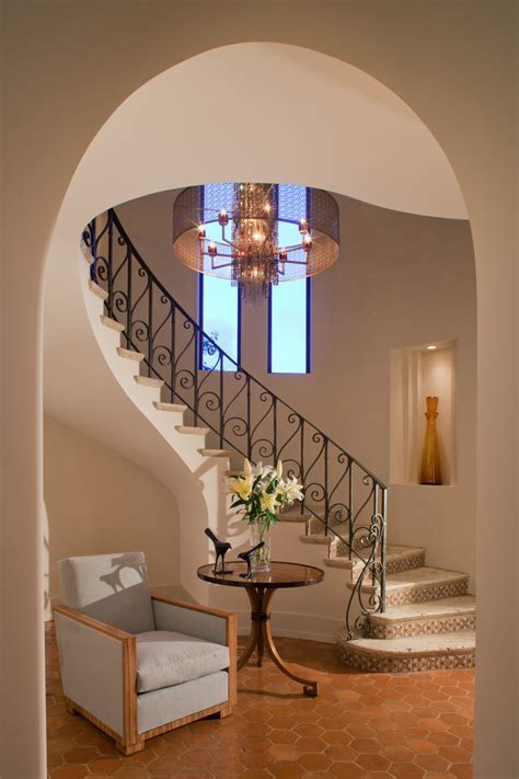 wrought iron stair railing Entry Traditional with arched