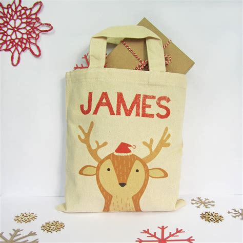 personalised animal christmas gift bag by fora creative
