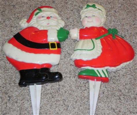 2 vintage 11 quot hard plastic santa mrs claus staked