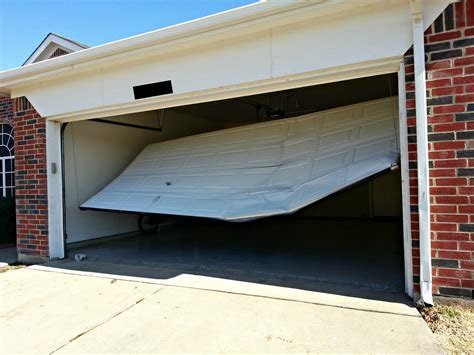 Open Garage Door With Broken by Wa Garage Doors Broken Panels Repair Replace New Panels