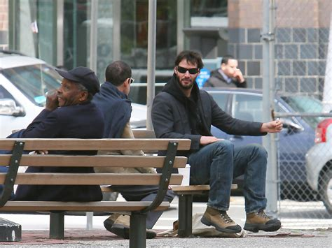 keanu reeves on a bench keanu reeves in keanu reeves drinks coffee in ny zimbio