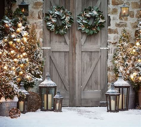 decorating a steel barn for christmas rustic barn doors decorated for the holidays from pottery barn luxe lodge