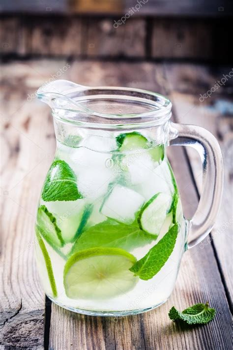Detox Water Cucumber And Lime by Detox Water With Cucumber Lime And Mint Stock Photo