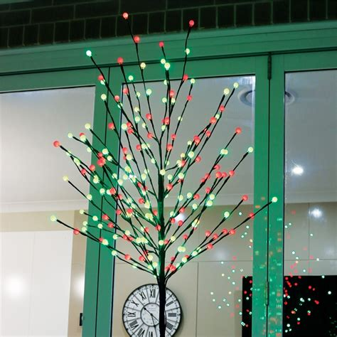 christmas trees from bunnings lytworx 1 8m 200 led and green auto switch light up tree i n 4351558 bunnings warehouse