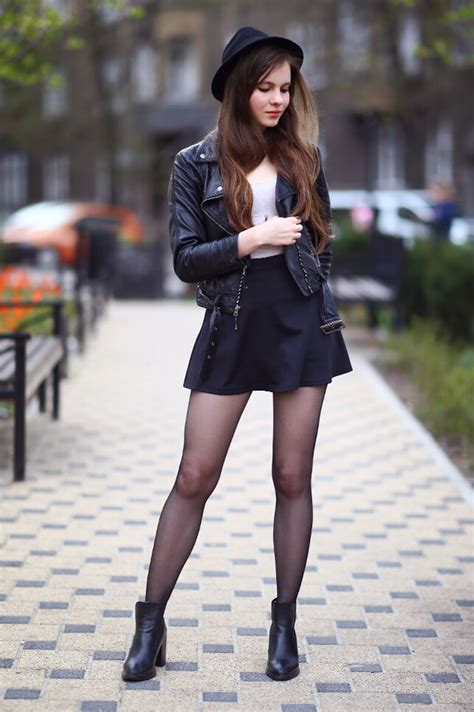 black leather jacket mini skirt hat and tights as
