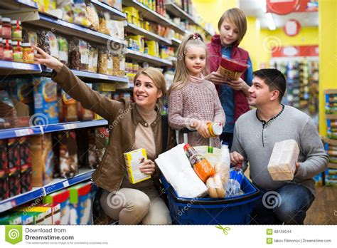 Time To Actually Buy Groceries by Family Buying Groceries In Supermarket Stock Photo Image